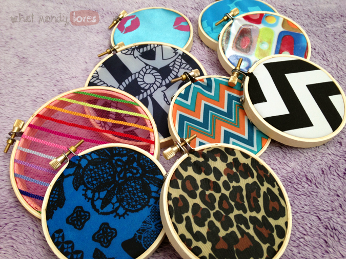What Mandy Loves: Image of a collection of embroidery hoops with fabric from makeup bags via www.whatmandyloves.com